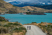 Walking the road along Lago Pehoe to Hosteria Pehoe, in Torres del Paine National Park, Ultima Esperanza Province, Chile, Patagonia, South America. The Park is listed as a World Biosphere Reserve by UNESCO.