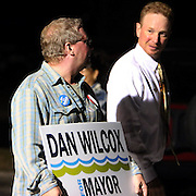 Former Carolina Beach Mayor Joel Macon holds a sign for candidate Dan Wilcox. (Jason A. Frizzelle)
