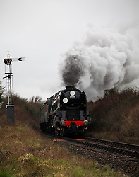 © Licensed to London News Pictures. 07/03/2014. Hampshire, UK. The steam locomotive '34046 - Braunton' on the Watercress Line today, 7th March 2014, which is the first day of the 'spring steam gala' on the Watercress Line. The railway line, operated by Mid Hants Railway Ltd, passes between Alresford and Alton in Hampshire. The line is named after its use in the past for transporting freshly cut watercress from the beds surrounding Alresford to London. Photo credit : Rob Arnold/LNP
