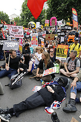 © Licensed to London News Pictures. 01/07/2017. London, UK. The People's Assembly anti-austerity demonstration sits down outside Downing St as it heads towards Parliament. Speakers include Labour Party Leader Jeremy Corbyn. Photo credit: Peter Macdiarmid/LNP