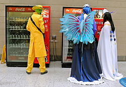 © Licensed to London News Pictures. 30/10/2011. London, UK. A man dressed as film character 'The Mask' buys a can of coke at a vending machine. The London Comic Con today, 30th October 2011 as fans of comics, computer games and Sci-Fi movies,  dress up as some of their favourite characters. The London MCM Expo takes place on 28-30th October 2011 at the excel centre in London.  Photo: Stephen Simpson/LNP