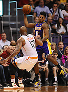 Dec 23, 2013; Phoenix, AZ, USA; Los Angeles Lakers forward Nick Young (0) jumps for the ball in the first half against the Phoenix Suns forward P.J. Tucker (17) at US Airways Center. Mandatory Credit: Jennifer Stewart-USA TODAY Sports
