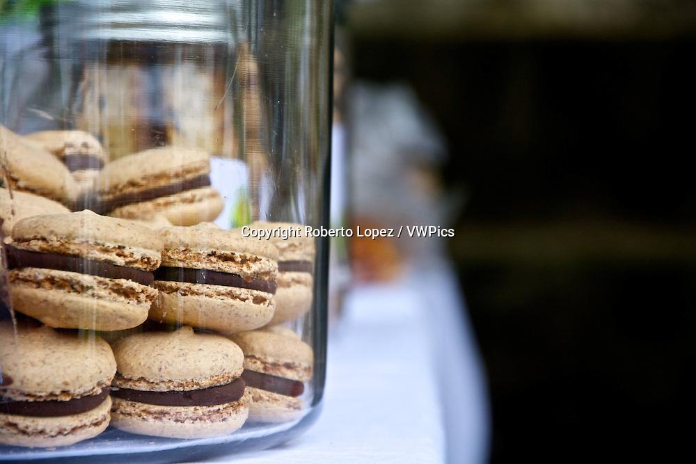 Close-up of a jar of macaroons at an organic fair.