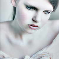 Close up of sad young girl with blonde hair