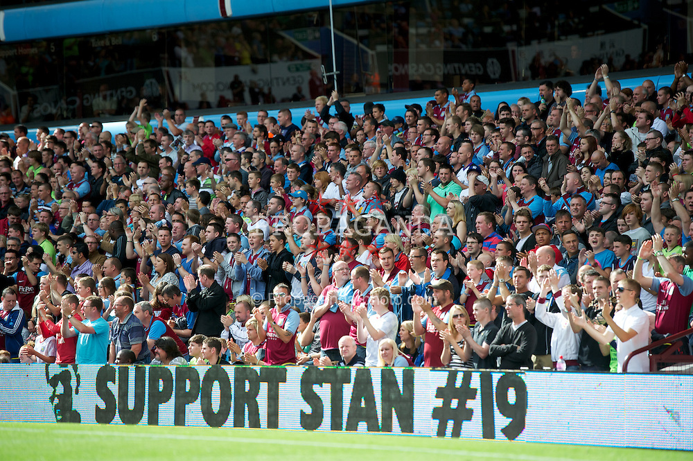 BIRMINGHAM, ENGLAND - Saturday, August 25, 2012: Aston Villa supporters stand for a minute's applause for Stylian Petrov, who is battling cancer, during the 19th minute of the game against Everton during the Premiership match at Villa Park. (Pic by David Rawcliffe/Propaganda)