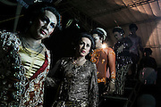 Transvestites walk out of stage after perfoming traditional folkfore perfomance in Mojokerto, East Java, Indonesia, June 9, 2015.