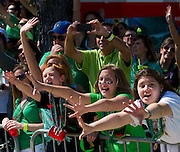Kids try to get beads from those in the parade on Greenville Avenue for the Dallas St. Patrick's Parade on Saturday, March 16, 2013. (Cooper Neill/The Dallas Morning News)