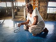 06 NOVEMBER 2014 - SITTWE, RAKHINE, MYANMAR: MOHAMMED HUSUN,  68, who is blind, prays in a temporary mosque built of palm fronds in an IDP camp for Rohingya Muslims near Sittwe. After sectarian violence devastated Rohingya communities and left hundreds of Rohingya dead in 2012, the government of Myanmar forced more than 140,000 Rohingya Muslims who used to live in and around Sittwe, Myanmar, into squalid Internal Displaced Persons camps. The government says the Rohingya are not Burmese citizens, that they are illegal immigrants from Bangladesh. The Bangladesh government says the Rohingya are Burmese and the Rohingya insist that they have lived in Burma for generations. The camps are about 20 minutes from Sittwe but the Rohingya who live in the camps are not allowed to leave without government permission. They are not allowed to work outside the camps, they are not allowed to go to Sittwe to use the hospital, go to school or do business. The camps have no electricity. Water is delivered through community wells. There are small schools funded by NOGs in the camps and a few private clinics but medical care is costly and not reliable.   PHOTO BY JACK KURTZ