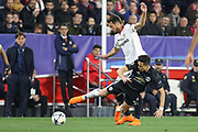 Manchester United Forward Alexis Sanchez tackles Sevilla midfielder Franco Vazquez (22) during the Champions League match between Sevilla and Manchester United at the Ramon Sanchez Pizjuan Stadium, Seville, Spain on 21 February 2018. Picture by Phil Duncan.