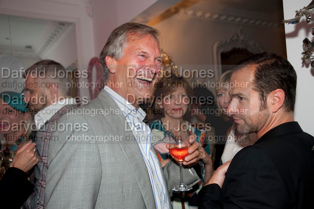 CHARLES DELEVIGNE; THE COUNTESS OF WOOLTON, Party at the home of Amanda Eliasch in Chelsea after the opening of As I Like it. A memory by Amanda Eliasch and Lyall Watson. Chelsea Theatre. Worl's End. London. 4 July 2010<br /> <br />  , -DO NOT ARCHIVE-&copy; Copyright Photograph by Dafydd Jones. 248 Clapham Rd. London SW9 0PZ. Tel 0207 820 0771. www.dafjones.com.