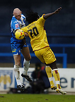 Photo: Olly Greenwood.<br />Colchester United v Burnley. Coca Cola Championship. 24/02/2007. Colchester's Kevin Watson and Burnley's Ade Akinbiyi