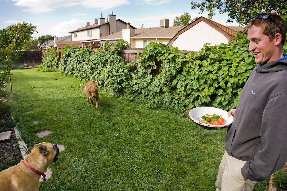 Bob Sorensen, an assistant golf course superintendent of The Golf Club at Redlands Mesa in Grand Junction, Colorado picks vegetables in his backyard.  (Bob Sorensen is featured in the book What I Eat: Around the World in 80 Diets.) He played football at Mesa State College in Grand Junction and graduated with a degree in criminal justice. Just before he took a desk job in his chosen profession he decided that he didn't want a desk job and found one that requires his constant attendance of the great outdoors, at a golf course at the foot of the majestic Colorado National Monument.  He earned a second degree in turf management, supervises a small crew of greenskeepers, and coaches high school football at Palisade High School.