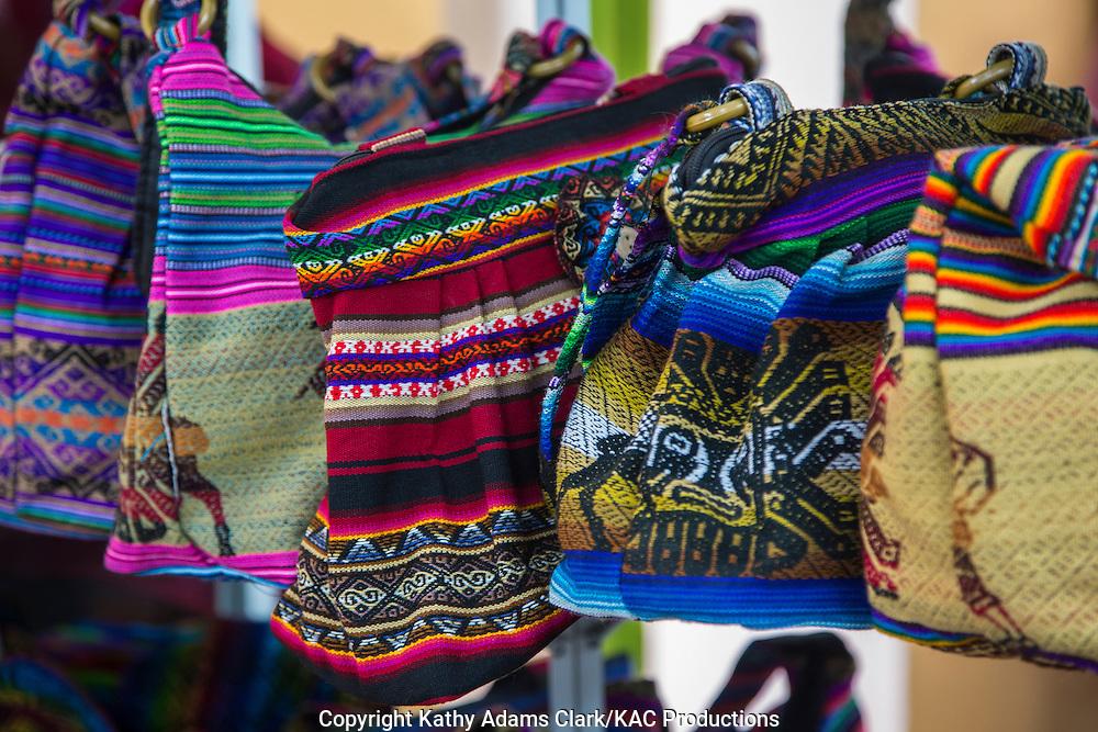 Handicrafts for sale in the market in Cusco, Peru.