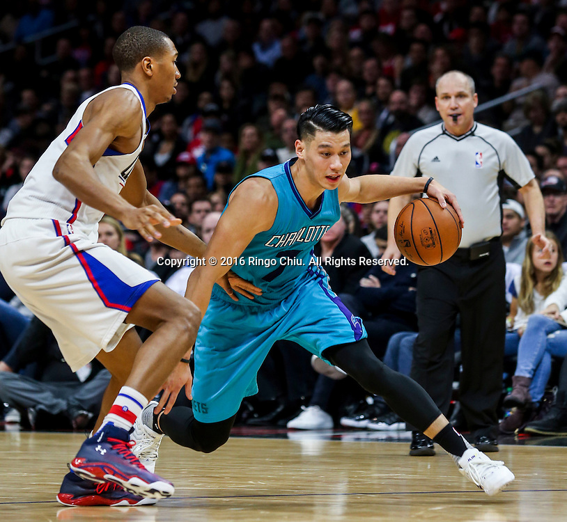 Charlotte Hornets Jeremy Lin drives against Los Angeles Clippers Wesley Johnson during the NBA basketball game in Los Angeles, the United States, Jan. 9, 2016. Los Angeles Clippers won 97-83. (Xinhua/Zhao Hanrong)(Photo by Ringo Chiu/PHOTOFORMULA.com)<br /> <br /> Usage Notes: This content is intended for editorial use only. For other uses, additional clearances may be required.