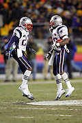 PITTSBURGH - JANUARY 23:  Asante Samuel #22 celebrates with fellow cornerback Eugene Wilson #26 of the New England Patriots after Wilson intercepts the first of two passes against the Pittsburgh Steelers during the AFC Championship game at Heinz Field on January 23, 2005 in Pittsburgh, Pennsylvania. The Pats defeated the Steelers 41-27. ©Paul Anthony Spinelli  *** Local Caption *** Eugene Wilson; Asante Samuel