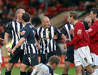 Photo: Dave Linney.<br />Walsall v Notts County. Coca Cola League 2. 25/11/2006.<br />Tempers flare  at Becot after a reckless challenge by Tommy Wright(Far Right)