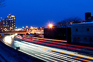 February 14, 2011 - Cars travel along the Massachusetts Turnpike through the city of Boston in the early morning. Photo by Lathan Goumas.