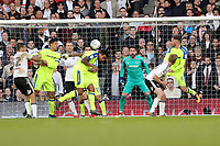 LONDON, ENGLAND - MAY 14:LONDON, ENGLAND - MAY 14:Tom Huddlestone, of Derby County clears the ball from a Fulham corner
