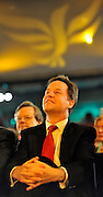 © Licensed to London News Pictures. 20/09/2011. BIRMINGHAM, UK.   Nick Clegg, Deputy Prime Minister watches Chris Huhne deliver a speech on the climate at the Liberal Democrat Conference at the Birmingham ICC today (20 Sept 2011): Stephen Simpson/LNP . Photo credit : Stephen Simpson/LNP