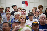 "Aug 10, 2009 -- CHANDLER, AZ: People, most opposed to health care reform, wave American flags during a town hall meeting on health care reform in Chandler, AZ. Rep. Jeff Flake, (R-AZ) hosted a ""town hall"" style meeting on health care reform at Basha High School in Chandler Monday. Flake, a conservative Republican, has opposed President Obama on many issues, like the stimulus and health care reform. Protestors who have shut down similar meetings hosted by Democrats, gave Flake a warm welome. About 1,600 people attended the meeting.   Photo by Jack Kurtz"