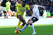 Sheffield Wednesday midfielder Jacques Maghoma (19) and Derby County midfielder Jeff Hendrick (8) during the Sky Bet Championship match between Derby County and Sheffield Wednesday at the iPro Stadium, Derby, England on 21 February 2015. Photo by Aaron Lupton.