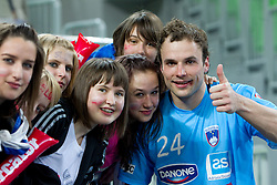 Uros Zorman of Slovenia with fans after winning the handball match between National teams of Slovenia and Poland of Qualification Group 3 for Men's EURO 2012, on March 9, 2011 in Arena Stozice, Ljubljana, Slovenia. Slovenia defeated Poland 30-28. (Photo By Vid Ponikvar / Sportida.com)