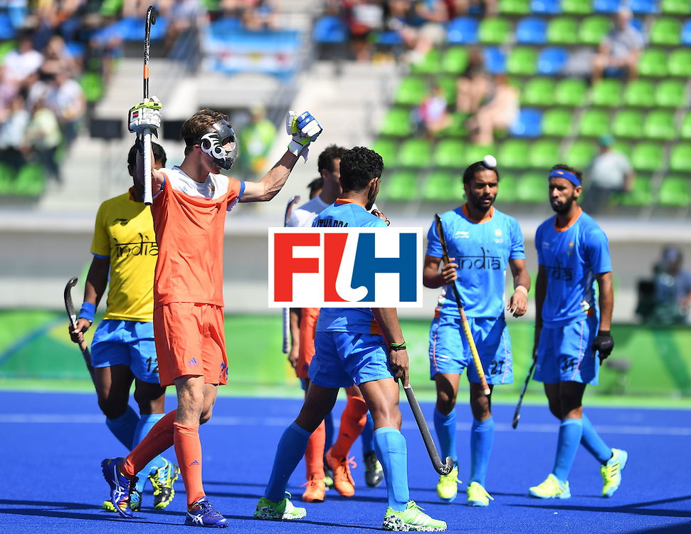 Netherland's Hidde Turkstra (2L) celebrates winning after the men's field hockey Netherland's vs India match of the Rio 2016 Olympics Games at the Olympic Hockey Centre in Rio de Janeiro on August, 11 2016. / AFP / MANAN VATSYAYANA        (Photo credit should read MANAN VATSYAYANA/AFP/Getty Images)