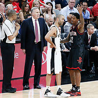 03 May 2017: referee Tony Brothers (25) talks to Houston Rockets head coach Mike D'Antoni as Houston Rockets guard Lou Williams (12) talks to San Antonio Spurs guard Tony Parker (9) during the San Antonio Spurs 121-96 victory over the Houston Rockets, in game 2 of the Western Conference Semi Finals, at the AT&T Center, San Antonio, Texas, USA.