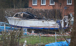 © Licensed to London News Pictures. 15/02/2017. Oxford, UK.  The remains of a burnt out boat is seen in front of a block of flats damaged in an explosion near Osney Lock in Oxford. A number of people have been injured in what is thought to have been a gas explosion. Photo credit: Peter Macdiarmid/LNP