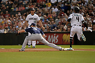 Sep 8, 2017; Phoenix, AZ, USA; Arizona Diamondbacks Ketel Marte (4) is safe at first against San Diego Padres infielder Wil Myers (4) in the first inning at Chase Field. Mandatory Credit: Jennifer Stewart-USA TODAY Sports