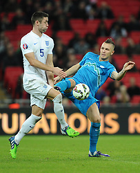 Gary Cahill of England (Chelsea) battles for the ball with Valter Birsa of Slovenia   - Photo mandatory by-line: Joe Meredith/JMP - Mobile: 07966 386802 - 15/11/2014 - SPORT - Football - London - Wembley - England v Slovenia - EURO 2016 Qualifier