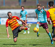 Partick's Stuart Brannigan flies in to tackle Hearts Harry Cochrane during the Pre-Season Friendly match between Partick Thistle and Heart of Midlothian at Central Park Stadium, Cowdenbeathl, Scotland on 8 July 2018. Picture by Malcolm Mackenzie.