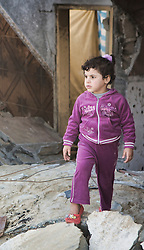 © Licensed to London News Pictures 29/11/2012.  Rafah refugee camp, Gaza. Eight days after the Israeli missile strikes a young girl walks across the rubble of her home.  This building was a complex of three houses with separate families.  Fortunately no one was injured or killed as the Israeli Defence Force (IDF) fired a warning bomb into the area prior to the strike.  The warning bomb is a loud sound that alerts the local people that an air strike is imminent.  This is the second time that this building has been hit, the first time being in 2008.  The family had just managed to re build it before it was destroyed.   Photo credit : Alison Baskerville/LNP
