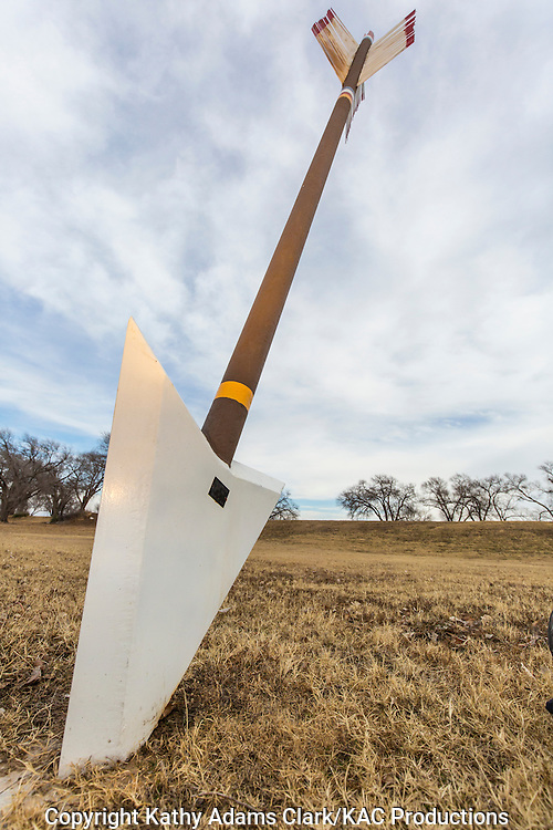 Large arrows in the ground are markers for the Quanah Parker Trail.  This marker in Canadian, Texas, commemorates the locations in Hemphill County where Comanches fought settlers.  Quanah Parker's grandfather was killed in one of these battles.