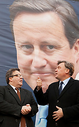 © Licensed to London News Pictures. 06/04/2013. London, UK. British shadow chancellor, Ed Balls (R) and the Deputy Chair of the Labour Party, Tom Watson, are seen at the unveiling of new poster to mark the reduction in the 50p tax rate as the new tax year begins of a poster by his political party in London today (06/04/2013). Photo credit: Matt Cetti-Roberts/LNP