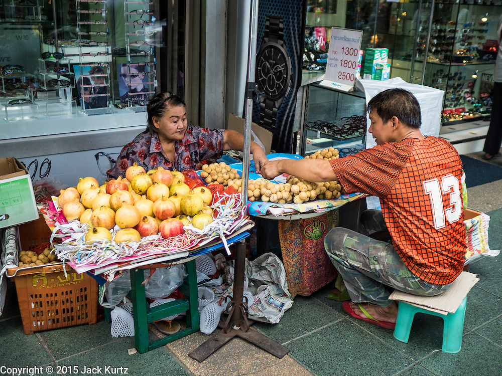 29 SEPTEMBER 2015 - BANGKOK, THAILAND: A street vendor selling pomegranate on Maharat Street in Bangkok. Vendors are being evicted from the area as a part of the Bangkok's gentrification efforts.     PHOTO BY JACK KURTZ