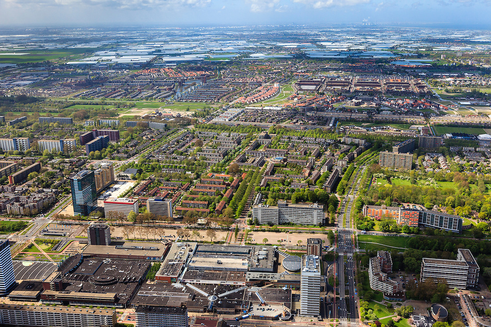 Nederland, Zuid-Holland, Rijswijk, 09-05-2013; zicht op Den Haag Wateringen en de kassen van het Westland. Beneden in beeld witte gebouw Hoogvoorde stadhuis Rijswijk aan de Sir Winstonn Churchillaan met rechts winkelcentrum In de Bogaard.<br /> View of Rijswijk, residential area built in the 60's, The Hague Wateringen and the greenhouses of the Westland.<br /> luchtfoto (toeslag op standard tarieven)<br /> aerial photo (additional fee required)<br /> copyright foto/photo Siebe Swart