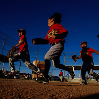 D-backs team members run to their dugout after their win over the Cubs on Thursday at Indian Hill Park in Gallup.