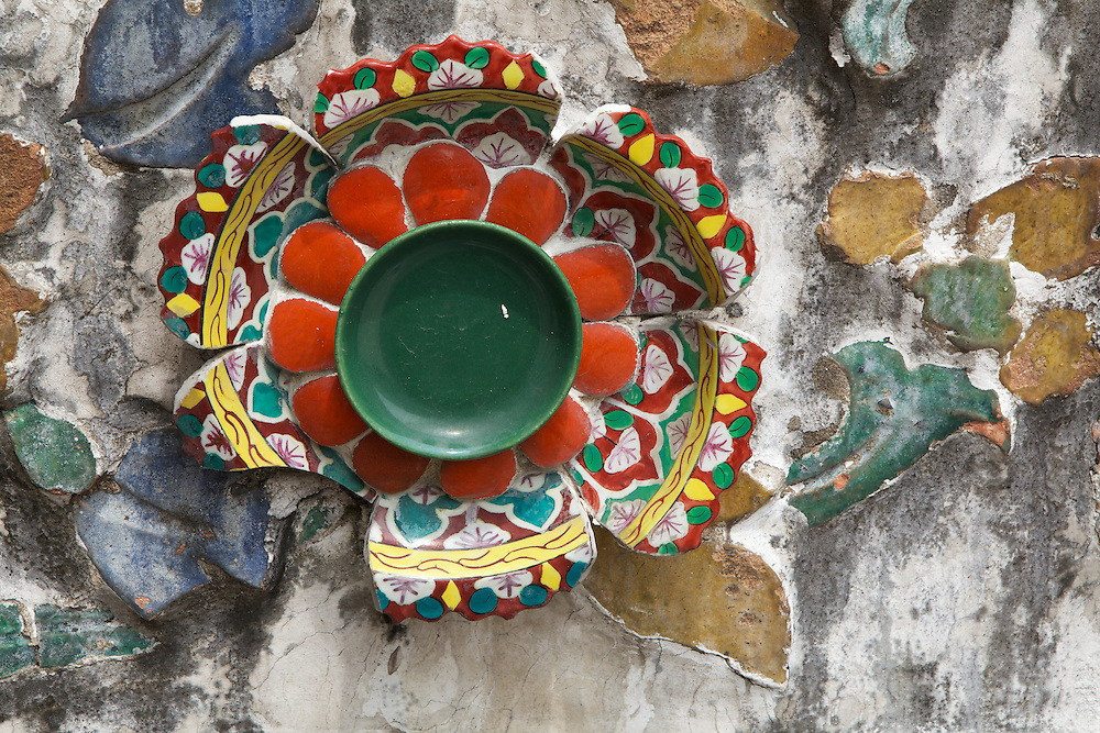 Chipped porcelain dish pieces reassembled to create the decorations on the exterior of the Temple of the Dawn (Wat Arun). The temple is decorated with (mostly) smashed bits of seashells and porcelain embedded in the plaster.