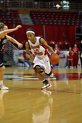 08 March 2008:Tiffany Hudson drives for the lane.  The University of Evansville Purple Aces and the Illinois State University Redbirds took the court looking for the MVC season title, but the Redbird win (87-72) split the title.  The game was played on Doug Collins Court in Redbird Arena in Normal Illinois.