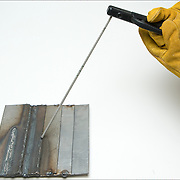 Welding lap joints in the flat position. Electrode position for lap joints in the horizontal position.<br /> <br /> Shielded metal arc welding (SMAW), or informally as stick welding, is a manual arc welding process that uses a consumable electrode coated in flux to lay the weld. An electric current, in the form of either alternating current or direct current from a welding power supply, is used to form an electric arc between the electrode and the metals to be joined.