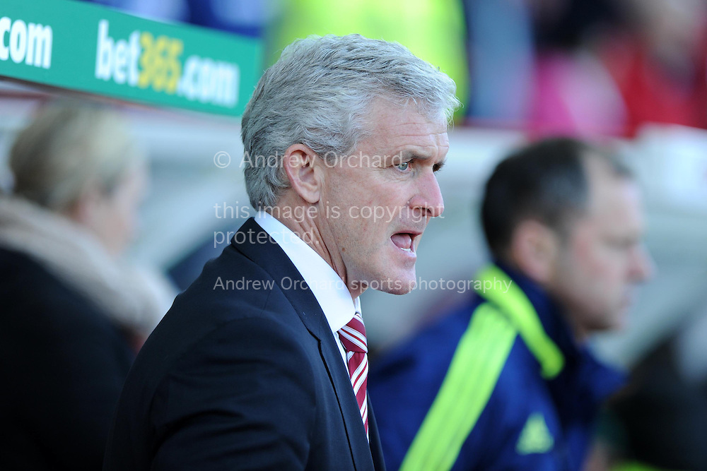 Stoke city manager Mark Hughes looks on before k/o. Barclays Premier league, Stoke city v Sunderland at the Britannia stadium in Stoke on Trent, England on Saturday 23rd Nov 2013. pic by Andrew Orchard, Andrew Orchard sports photography,