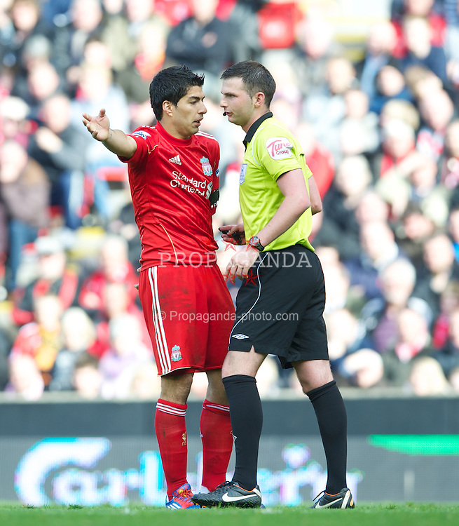 LIVERPOOL, ENGLAND - Saturday, April 7, 2012: Liverpool's Luis Alberto Suarez Diaz is spoken to by referee Michael Oliver during the Premiership match against Aston Villa at Anfield. (Pic by David Rawcliffe/Propaganda)