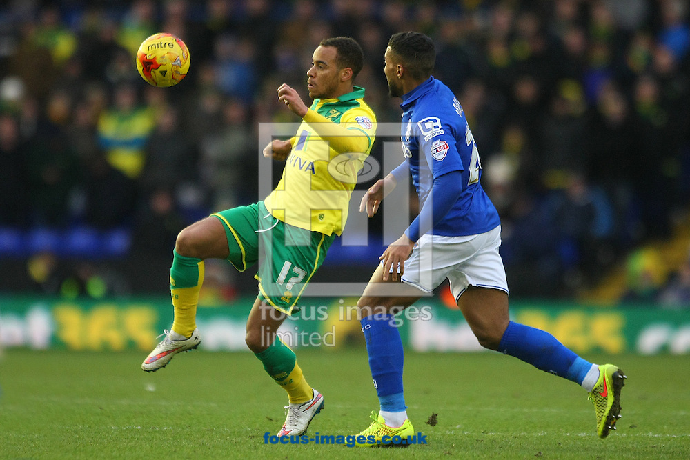 Elliott Bennett of Norwich and David Davis of Birmingham in action during the Sky Bet Championship match at St Andrews, Birmingham<br /> Picture by Paul Chesterton/Focus Images Ltd +44 7904 640267<br /> 31/01/2015