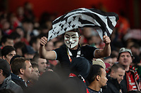 Football - 2018 / 2019 UEFA Europa League - Round of Sixteen, Second Leg: Arsenal (1) vs. Rennes (3)<br /> <br /> Rennes FC fan wearing a mask waves a Brittainy flag at The Emirates.<br /> <br /> COLORSPORT/DANIEL BEARHAM