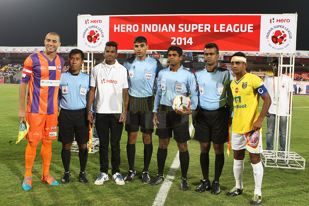 The Hero fan poses with match officials and the team captains during match 17 of the Hero Indian Super League between FC Pune City<br /> and Kerala Blasters FC held at the Shree Shiv Chhatrapati Sports Complex Stadium, Pune, India on the 30th October 2014.<br /> <br /> Photo by:  Ron Gaunt/ ISL/ SPORTZPICS