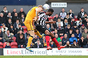 Port Vale defender Nathan Smith (24) and Grimsby Town forward Jamille Matt (29) battles for possession  during the EFL Sky Bet League 2 match between Grimsby Town FC and Port Vale at Blundell Park, Grimsby, United Kingdom on 10 March 2018. Picture by Mick Atkins.