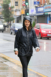 © Licensed to London News Pictures. 27/06/2020. London, UK. A woman smiles during rainfall in north London following a very hot week which saw highest temperature of the year so far. Photo credit: Dinendra Haria/LNP