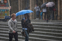© licensed to London News Pictures. London, UK 24/06/2012. People walking under the rain in central London, today (24/06/12). Photo credit: Tolga Akmen/LNP