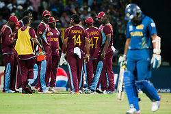 © Licensed to London News Pictures. 29/09/2012. West Indian team get into huddle as Tillakaratne Dilshan departs during the T20 Cricket World super 8's match between Sri Lanka Vs West Indies at the Pallekele International Stadium Cricket Stadium, Pallekele. Photo credit : Asanka Brendon Ratnayake/LNP